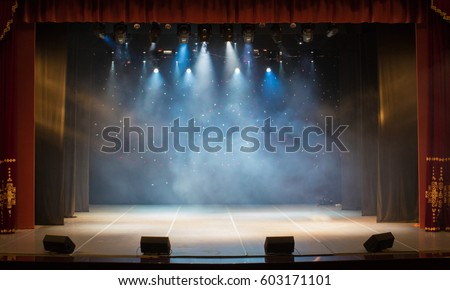 An empty stage of the theater, lit by spotlights and smoke before the performance #603171101
