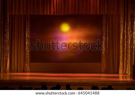 An empty stage of the theater, lit by spotlights and smoke before the performance - Shutterstock ID 645041488