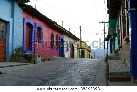 An empty street with typical Mexican houses, low architecture, bright and vibrant colors. San Cristobal de las  Casas, Chiapas, Mexico