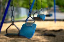 An empty swing in Nellies Cave Park, a public park in Blacksburg, VA.