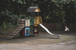 An empty vintage playground for children in the park. London.