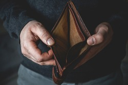 An Empty wallet in the hands of a young man