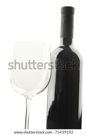 An empty wine glass and a bottle