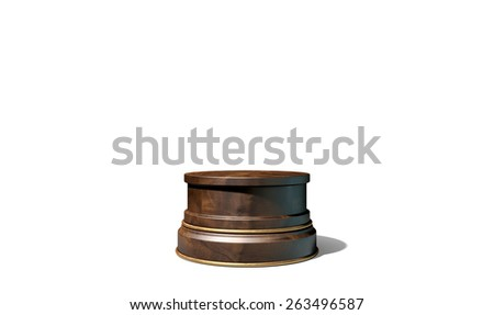 An empty wood and brass trophy base on an isolated black studio background