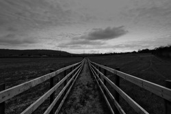 An enclosed footpath with wooden fences, across land which is earmarked for building the HS2 railway, near Wendover, in Buckinghamshire, England.