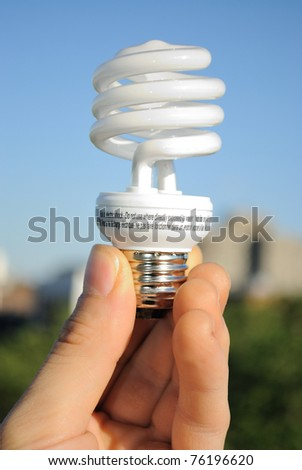 An energy efficient florescent light bulb. - stock photo