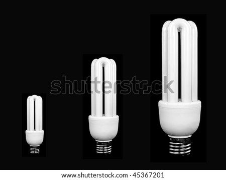 An energy saving light bulbs isolated against a black background