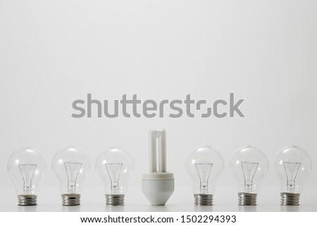 An energy saving lightbulb and ordinary lightbulbs #1502294393