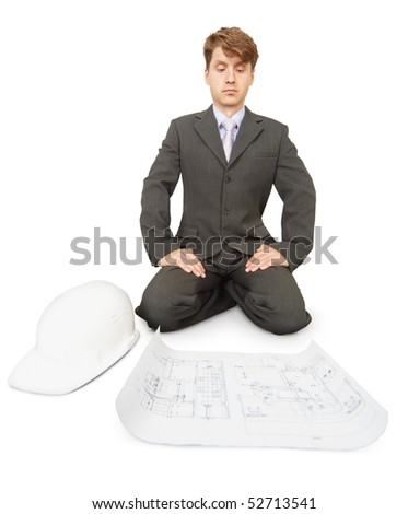 An engineer is thinking over the drawing, isolated on a white background