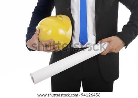 An engineer or architect holding blueprint and helmet