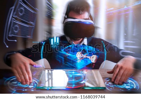 An engineer with oculus designs an electric car using sophisticated and futuristic programs with holography. Concept of: cars, future, project and augmented reality.