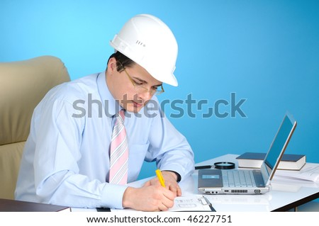 An engineer with white hard hat at work  on blue background #46227751