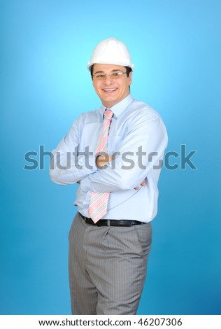 An engineer with white hard hat on blue background