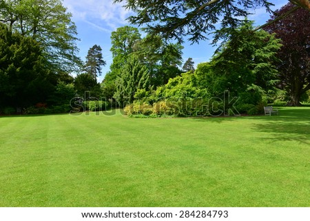Shutterstock An English country garden in June 2015 at a burned out shell of a house
