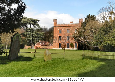 An English Country Mansion and Gardens viewed from a Churchyard