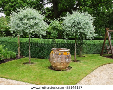An English Landscape garden with large earthenware Pot