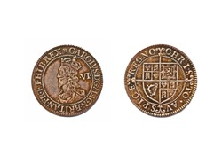 An English pre-decimal sixpence dating from around 1631 with the bust of King Charles I on the obverse and isolated on a white background.