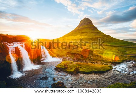An epic sunset with Kirkjufellsfoss waterfall. Location Iceland, Europe. Scenic image of tourist attraction. Travel destination of most popularly photographed place. Discover the beauty of earth. #1088142833