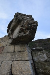 An eroded concrete block on the sea wall at Pentewan Cornwall