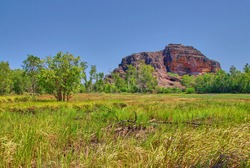 An eroded, steep red and grey colored hillside in the Northern Territory Outback of Australia.