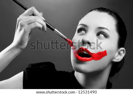 an erotic portrait of a lady with paint on face