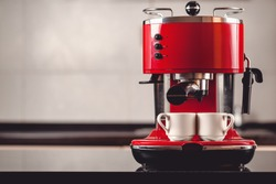 An espresso machine and two cups