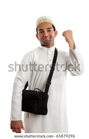 An ethnic arab or south asian man dressed in traditional cultural clothing.  He is smiling and one arm clenched in a victory fist of success