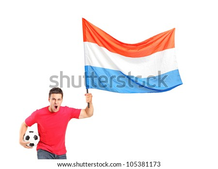 An euphoric fan holding a ball and waving a dutch flag isolated on white background