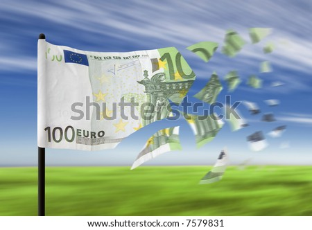 An euro banknote paper money falling into pieces in the wind denoting a financial crisis.