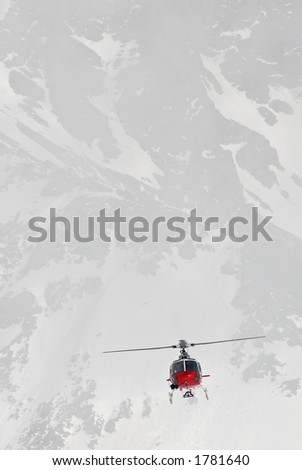 An Eurocopter comming in to land on a mountain hut in Switzerland.