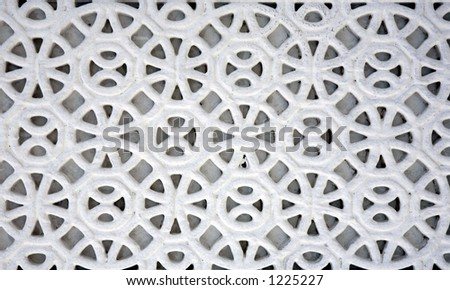 An example of Islamic design cast in concrete on a building in Doha, Qatar, crudely painted white. As Islam bans the depiction of human or animal forms, artists developed their style using shapes.