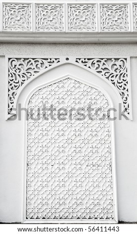 An example of Islamic mosque design cast in concrete on a building in Terengganu, Malaysia.