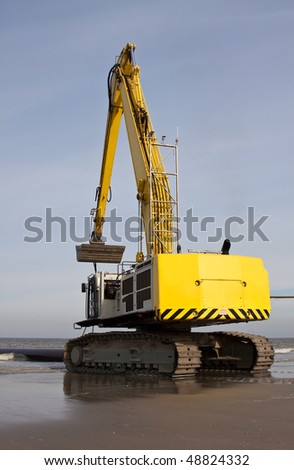 An Excavator on the beach of Scheveningen NL