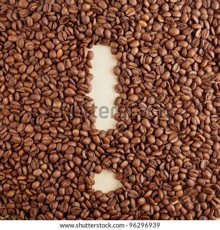 An exclamation mark symbol made from coffee crops on handmade paper - stock photo