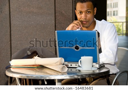 An executive engineer conducting work during his lunch hour. - stock photo