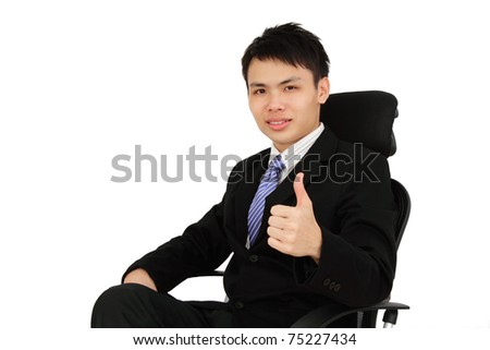 An executive showing the thumbs up while sitting on a chair