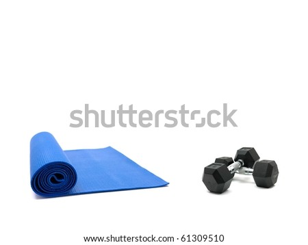 An exercise mat and hand weights isolated against a white background