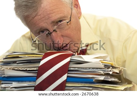 An exhausted businessman has had too much of his paperwork.