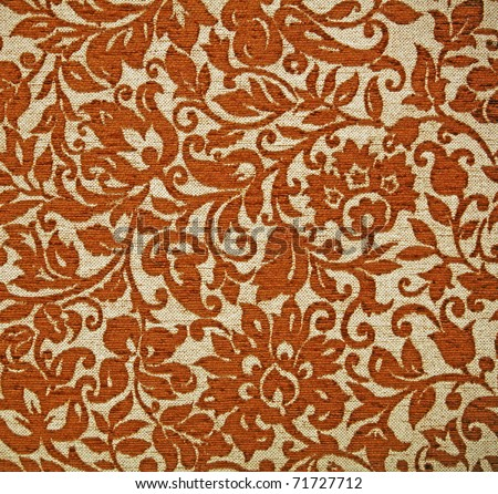 An exotic brown color Javanese floral pattern weaved fabric as textural background.