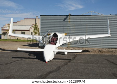 An experimental plane at a small airport.
