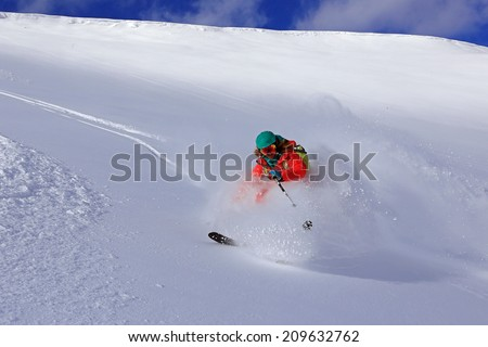 An expert skier skiing in the Utah mountains, USA.