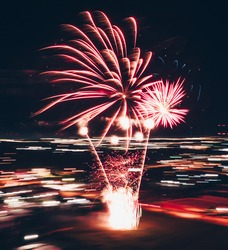 An explosion of fireworks from above. The photo was taken on the engine.