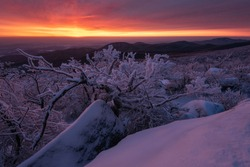 An explosive sunrise fills the sky above Shenandoah National Park, Virginia as a snowstorm a few days ago coated the landscape in ice.