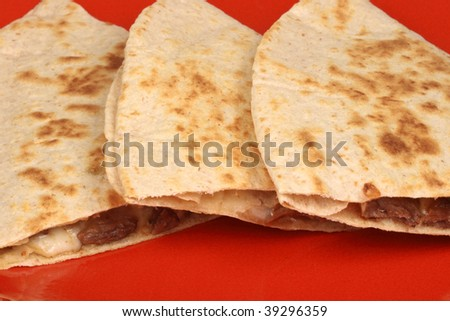 An exquisite organic mexican quesadillas with wheat corn tortilla and hormone free beef