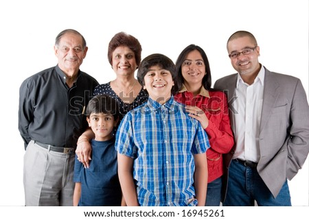 An extended Indian family all pose together in a fun setting