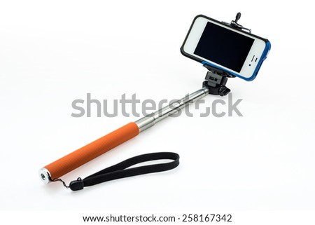 an extensible selfie stick with an adjustable clamp on the end on a white background - Shutterstock ID 258167342