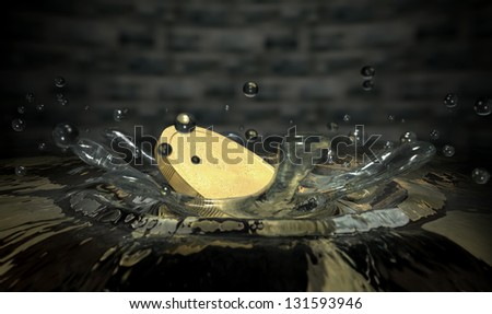 An extreme closeup of a gold coin hitting the surface of the water making a splash and droplets