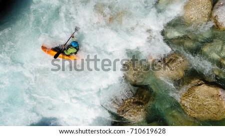 an extreme whitewater kayaker...