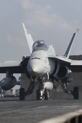 An F/A-18C Hornet Awaits Catapult Assisted Takeoff on the Nuclear Aircraft Carrier, USS Enterprise