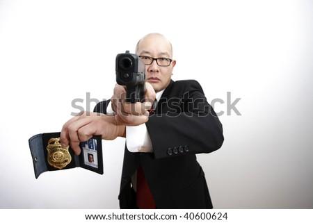 man with gun badge - photo #6